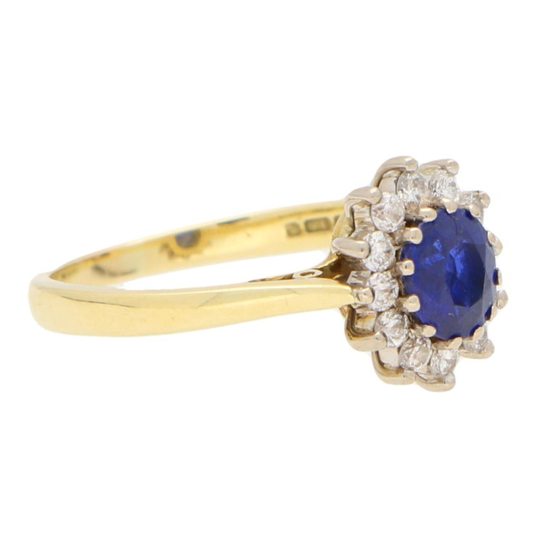 Oval Cut Sapphire and Diamond Cluster Ring Set in 18 Karat Yellow and White Gold For Sale