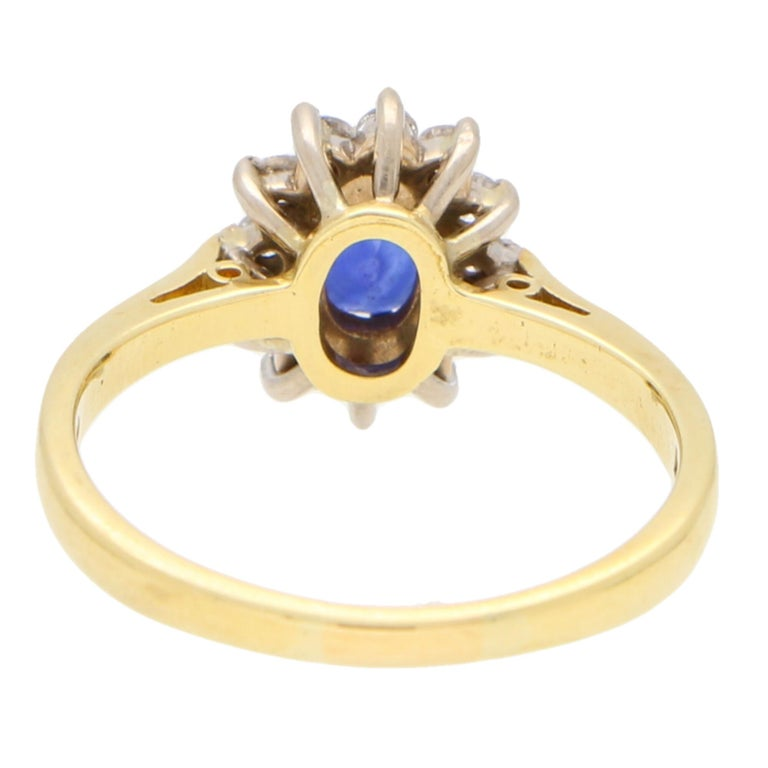 Women's or Men's Sapphire and Diamond Cluster Ring Set in 18 Karat Yellow and White Gold For Sale