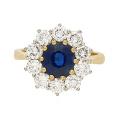 Sapphire and Diamond Cluster Engagement Ring Set in 18k Yellow and White Gold