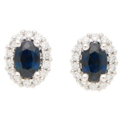 Sapphire and Diamond Cluster Halo Earrings in White Gold