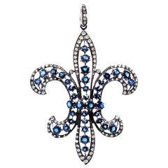 Sapphire and Diamond Fleur de Lis Pendant, Necklace 18 Karat and Chain