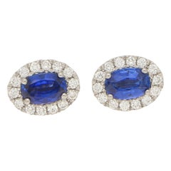 Sapphire and Diamond Oval Halo Earrings in 18 Carat White Gold