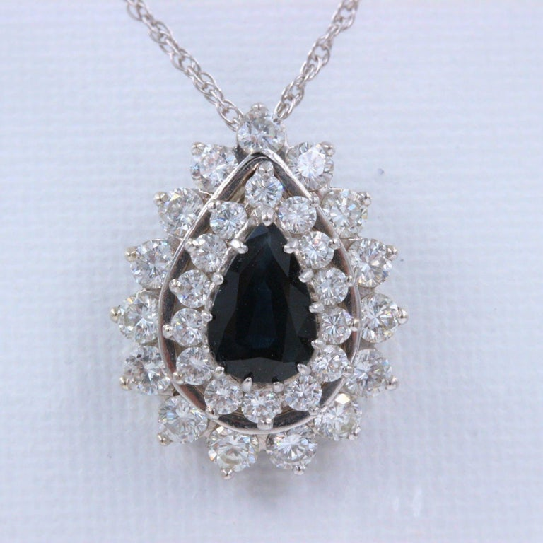 SAPPHIRE & DIAMOND PENDANT NECKLACE Metal:  14K White Gold Length:  15 Inches Pendant Width:  .75 X .60 Inches X 9 MM Height Total Carat Weight: 4.78 tcw Center Stone:  Pear Shape Dark Blue Sapphire 2.44 cts Diamonds:  29 Round Diamonds 2.34 tcw