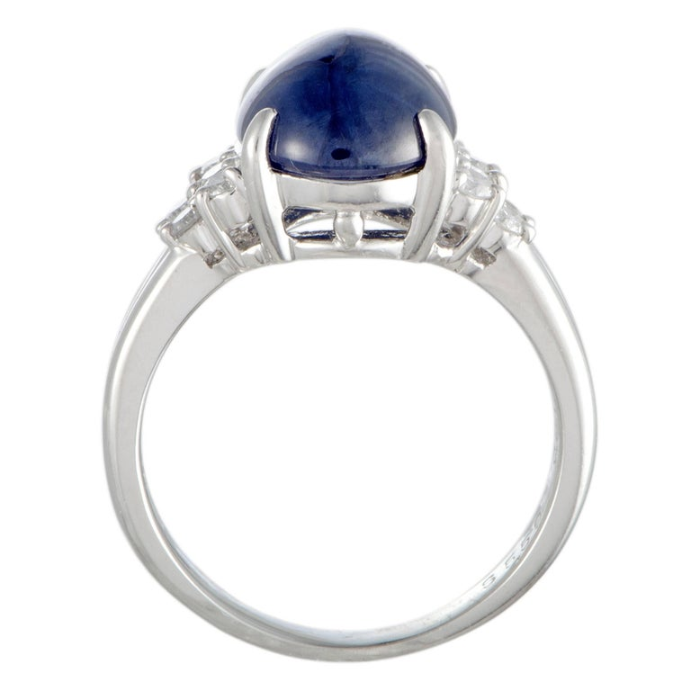Splendidly crafted from prestigious platinum, this fabulous ring exudes elegance and refinement. The ring is set with 0.27 carats of diamonds that accentuate an eye-catching sapphire weighing 5.59 carats. Ring Top Dimensions: 12mm x 15mm Band: