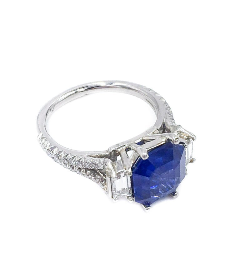 This is truly a special ring. The 4.01 carat is not your average sapphire, it is a modified octagonal cut making it distinct as well as versatile.  The beautiful cornflower blue will pop from anyone's hand.  Expertly set and handcrafted in platinum,