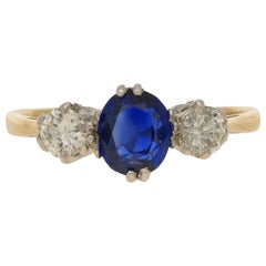 Sapphire and Diamond Three-Stone Trilogy Engagement Ring in Gold and Platinum
