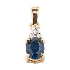 Sapphire and Diamonds Pendant in 14 Karat Gold