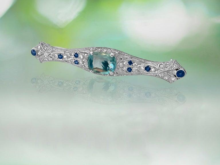 Round Cut Sapphire Diamond and Aquamarine Art Deco Style Pin For Sale