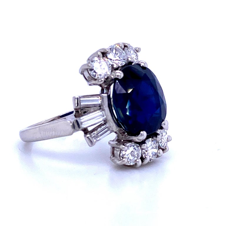 Oval Cut Sapphire Diamond Cocktail Ring 6.52 Carat Platinum For Sale