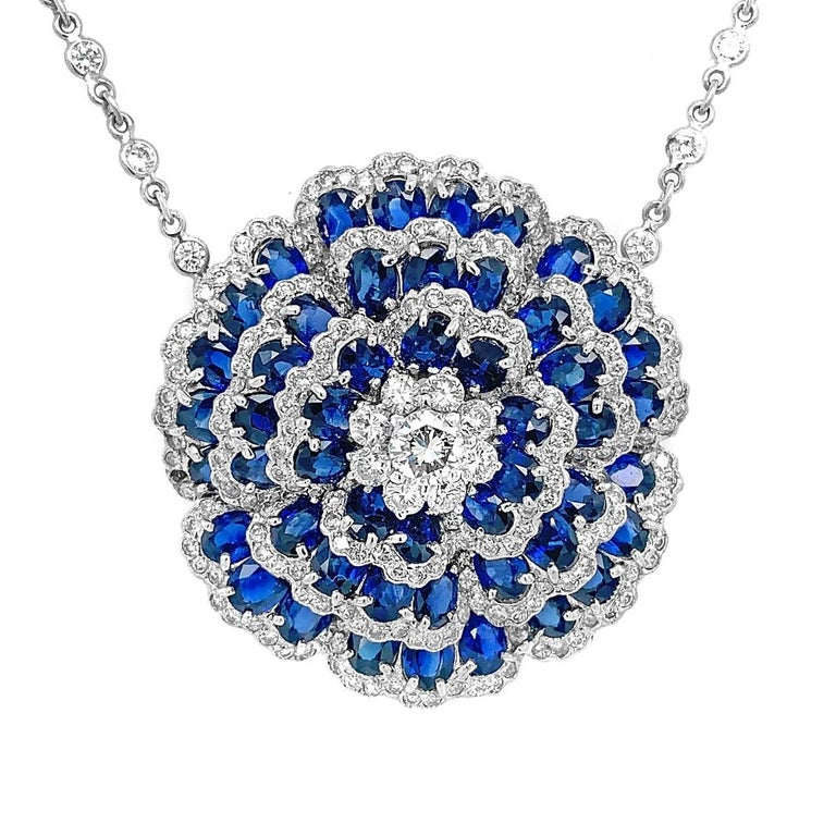 Sapphire Diamond Flower Necklace  Condition: Excellent Style: Chain Gemstone: Sapphire & Diamond Item Weight: 20.1 grams Length: 4.3 inch Width : 1.2 inch
