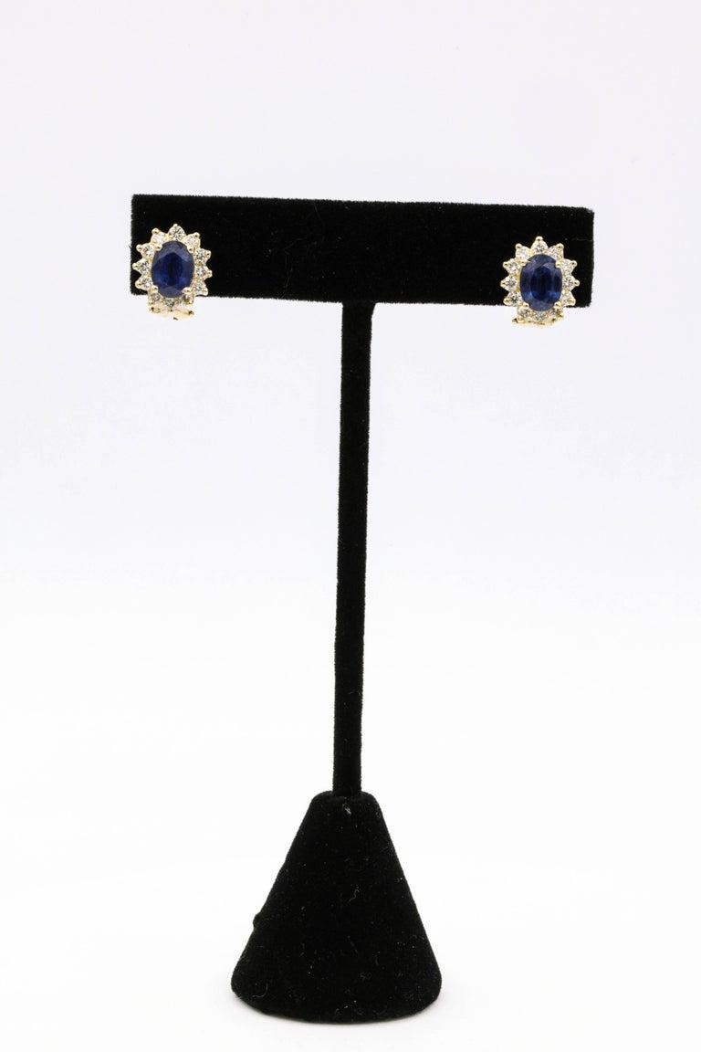 Oval Cut Sapphire Diamond Halo Stud Earrings 4.14 Carat 14 Yellow Gold For Sale