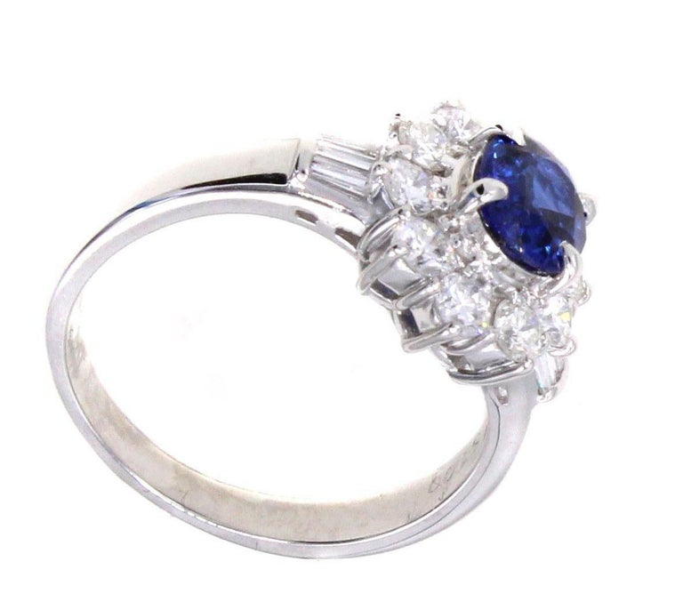 A deep blue lively oval cut sapphire weighing 1 carat is the center piece of this charming engagement ring. Mounted in hand-crafted platinum mounting the center gem is embellished by 8 perfectly matched white bright and sparkly round brilliant cut