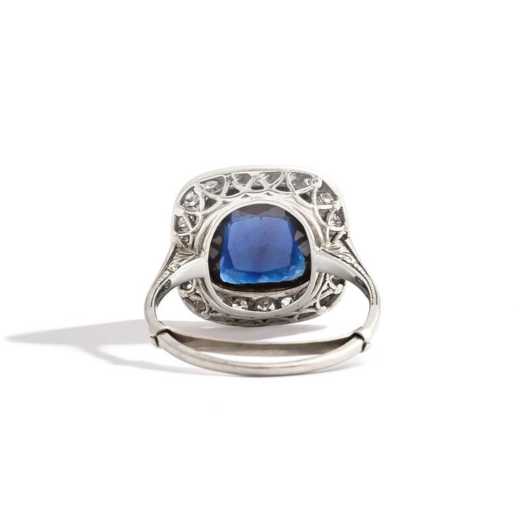 Sapphire cabochon surrounded by diamond on white gold and platinum Ring. Sapphire Size: 10.00 x 10.00 millimeters. Thickness: 3.86 millimeters. Ring Size: 6 3/4. Gross weight: 4.00 grams.