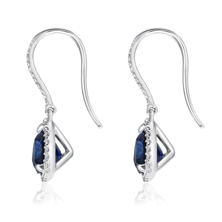 Sapphire earrings, featuring a pair of trillion shaped blue Sapphires weighing a total of 3.14 carats and adorned by a total of 0.23 carats of round brilliant diamonds. Crafted in 18K white gold. Total length: 0.75 inches. Returns are accepted and