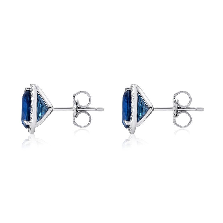 Sapphire stud earrings featuring a pair of round Sapphires weighing a total of 4.12 carats surrounded by a total of 0.20 carats of round brilliant diamonds, in 18K white gold. Returns are accepted and paid by us within 7 days of delivery.  Sapphire