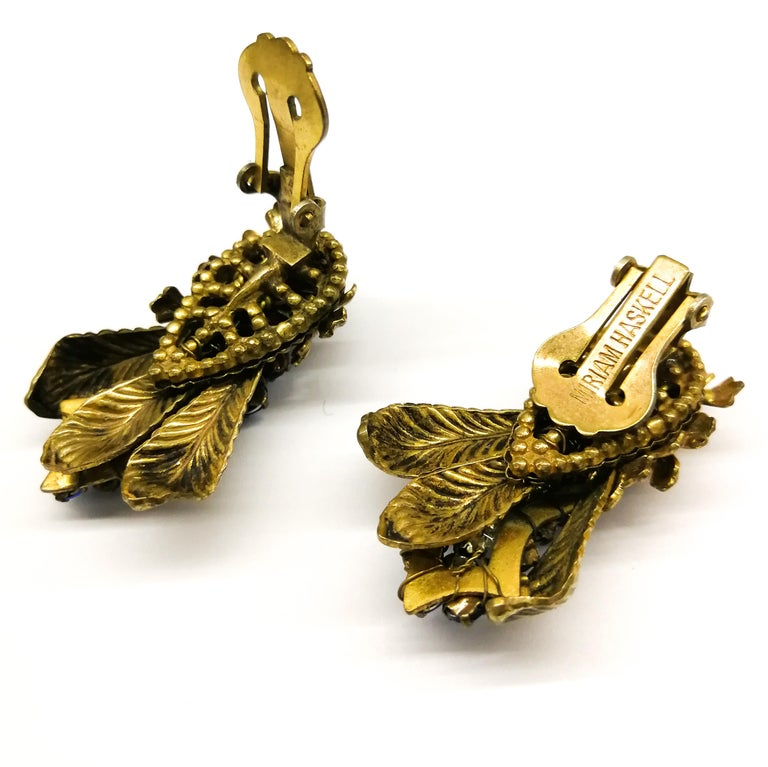 Baroque Sapphire glass pastes and gilt metal earrings, Miriam Haskell, 1950s For Sale