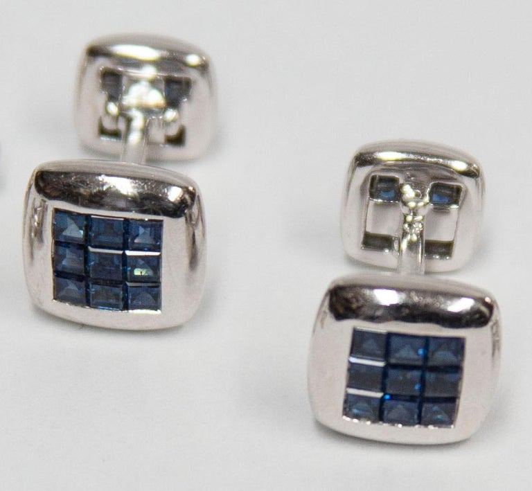 Classic Blue Sapphire Dress Set comprising Pair of Cuff links and four matching Shirt Studs, each centering 9 invisible set square calibrated Sapphires. Marked: 750 (Gold standard for 18K). Hand crafted in 18 Karat white gold. For that Special Man