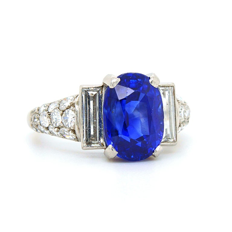 An Art Deco sapphire and diamond ring in platinum, France, ca. 1920s. The cushion shaped sapphire weighs 5.12 carats and is natural, not heated - accompanied by a gemological report by DSEF. The sapphire has a stunning royal blue colour and crystal