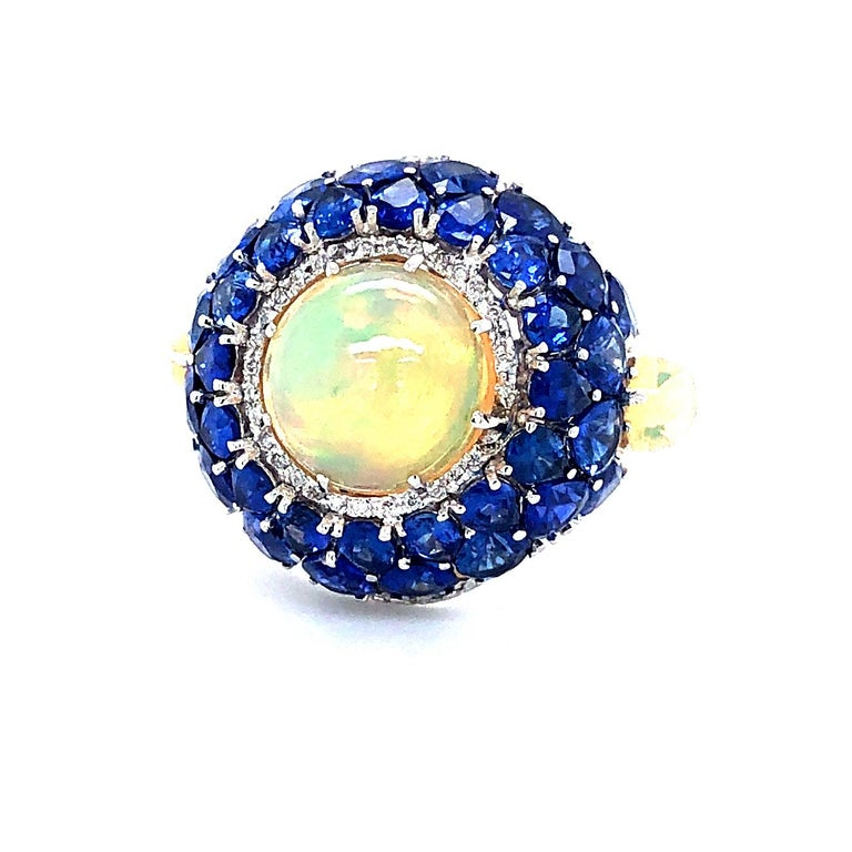 Offered here is a gorgeous Ethiopian Opal with Sapphire and diamonds ring. The ring is 18kt ( marked 750 and 2144M ). The ring is a finger size 7, that can be sized. The ring has two (2) pear shaped Ethiopian Opal and one (1) round cabochon