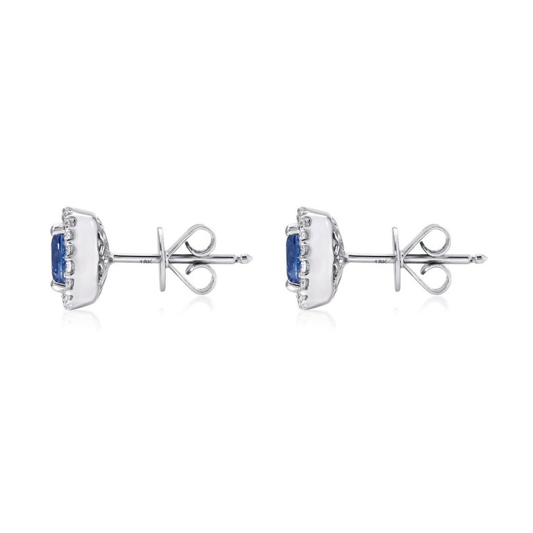 Sapphire earrings featuring a cushion cut pair weighing a total 1.96 carats,  framed by a total of 0.35 carats total round brilliant diamonds, in 18K white gold.  Returns are accepted and paid by us within 7 days of delivery.   Colorful alternatives