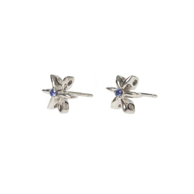 These pretty dainty Daisy earrings have been set with Blue Sapphires in White Gold. We think they look fabulous in White Diamonds or with other birthstones too and can make these to order in our workshop in Italy for you. I would be delighted to