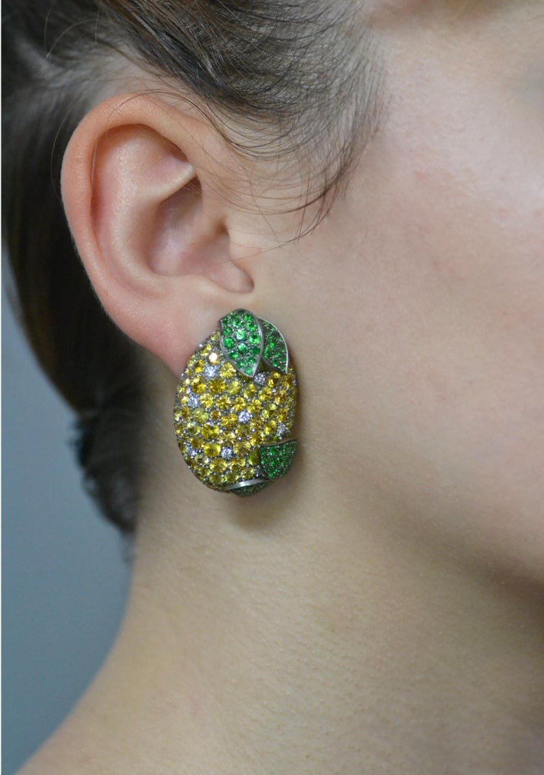 Handcrafted in Italy, the Lemon earrings are realized in  titanium, then they are extremely light. Set in yellow sapphires and diamonds, are decorated with leaves set in vivid green tsavorite.    sizes: 1.37 inches by 1.02 inches -  3,48 cm altezza