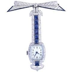 Sapphires Diamonds Onyx Platinum Swiss Brooch Watch, 1920