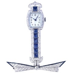 Sapphires Diamonds Onyx Platinum Swiss Brooch Watch, 1920