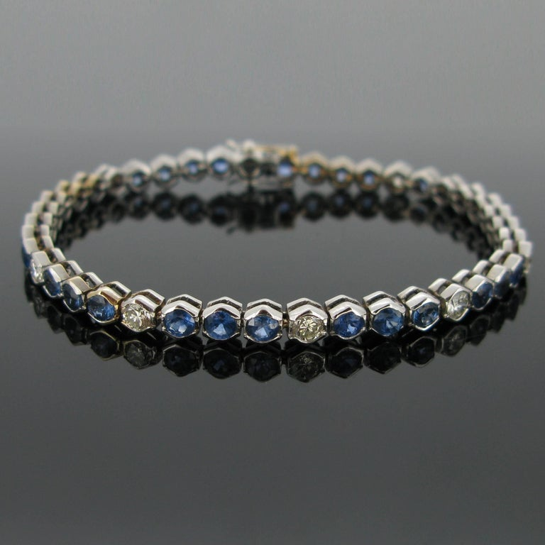 A sapphires and diamonds tennis bracelet. This timeless line is set with 10 brilliant cut diamonds (tcw : 1,20ct approximately) and with 32 sapphires for a total weighing around 6,40ct.   The name Tennis Bracelet is related to a professional tennis