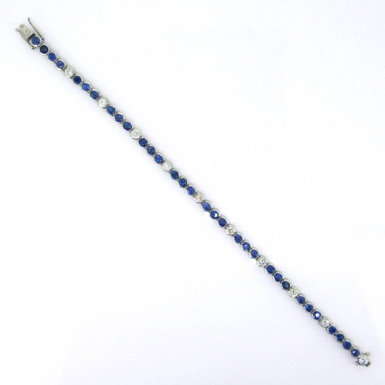 Contemporary Sapphires Diamonds White Gold Tennis Bracelet For Sale