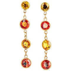 Glittering Sapphires in Dangling Gold Stud Earrings