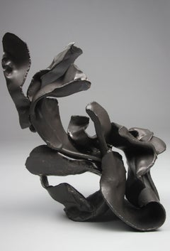 """Tuck"", gestural, ceramic, sculpture,  matte black, amber, stoneware"