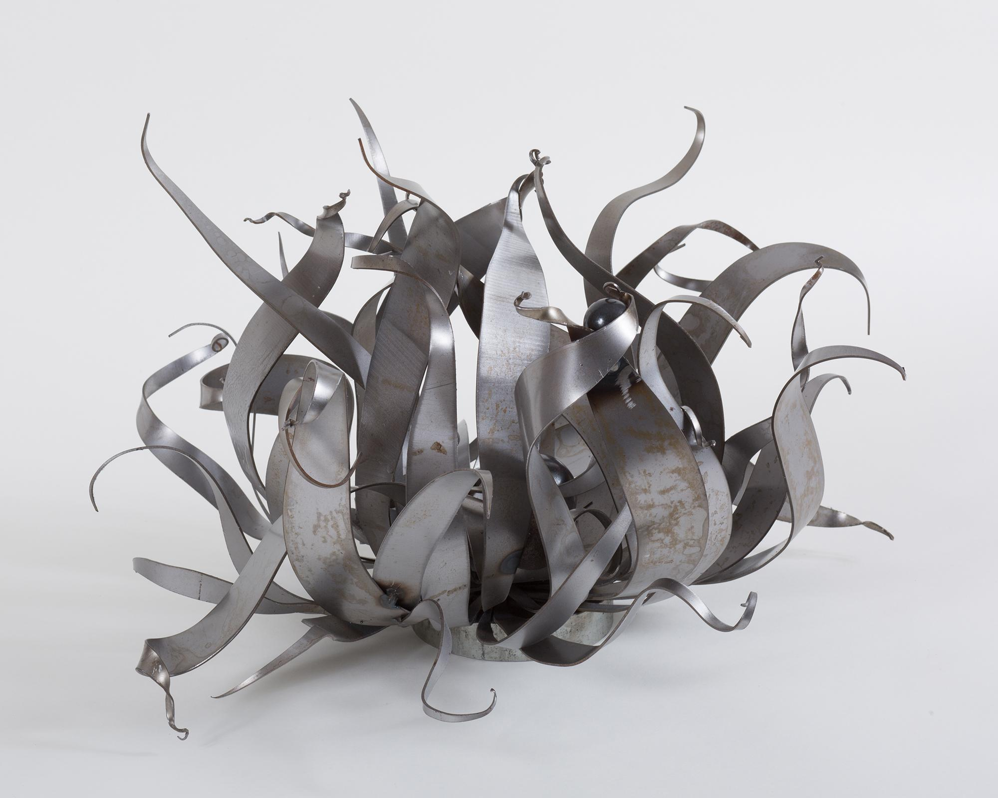 """Relentless"", steel, iron, sculpture, grassy shapes"
