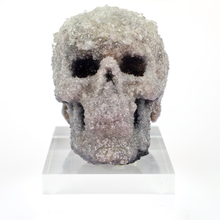 This Crystal Skull Sculpture by Sarah Raskey is a 5 x 4 x 6 inch textured mixed media sculpture composed of studio grown crystals. Acrylic base included.  Sarah Raskey is a visionary artist, a licensed clinical professional psychotherapist, a