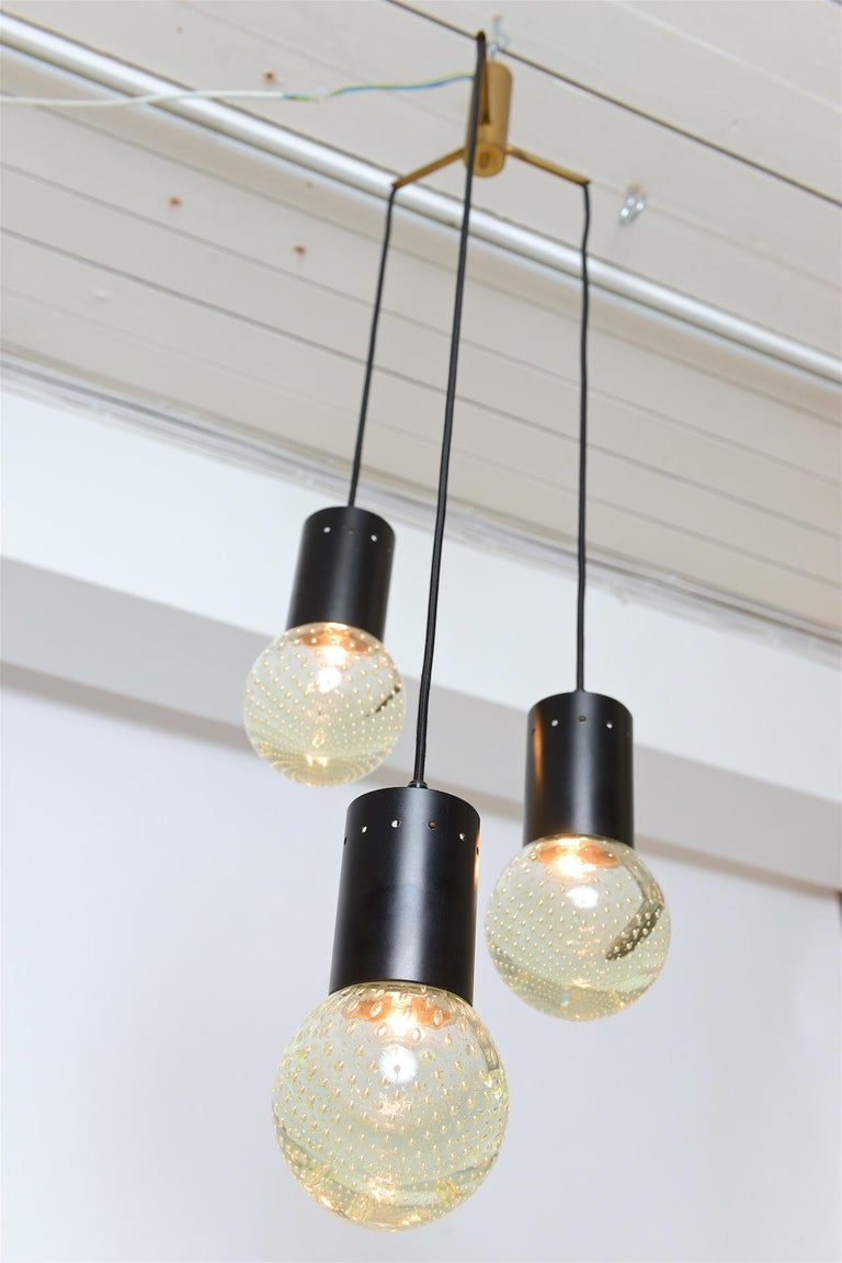 Chandelier with three glass globes. Lovely speckled light reflected through glass globes. 