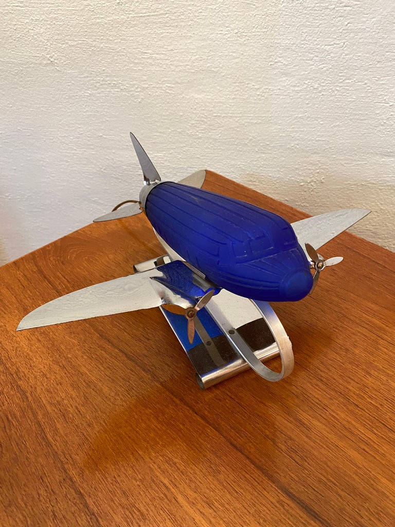 Sarsaparilla chrome and blue glass airplane lamp from the early 1980's all original and pretty clean. Sarsaparilla made a lot of deco inspired lamps and accessories in the 1970's and 80's.