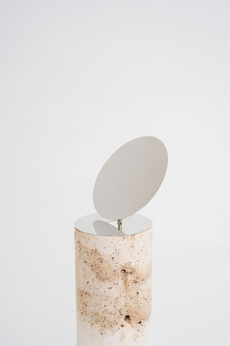 Satellite 3 by Turbina Dimensions: Ø 12 cm x H 120 cm  Also Available in: Ø 12 cm x H 80 cm Ø 12 cm x H 100 cm  Materials: MDF  Satellite project arises from the idea of the stone as symbol of sacredness. Nickel brass plated discs slow