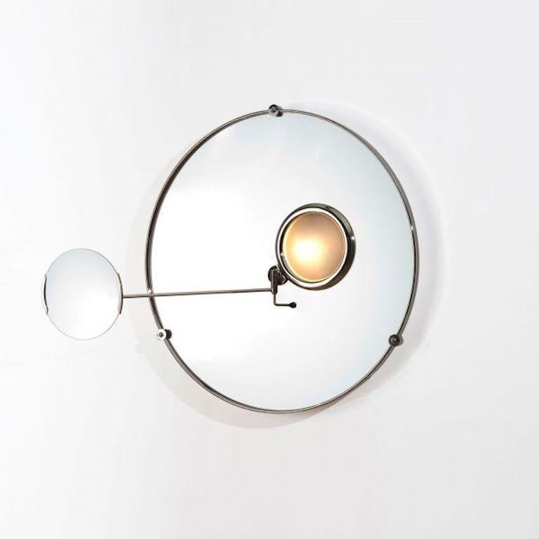 Satellite mirror by Eileen Gray for Ecart. Originally designed in 1927. Current production designed and manufactured in France. Nickel plated brass structure, mirror, sanded convex glass cover. The magnifying mirror is maintained by two blocking