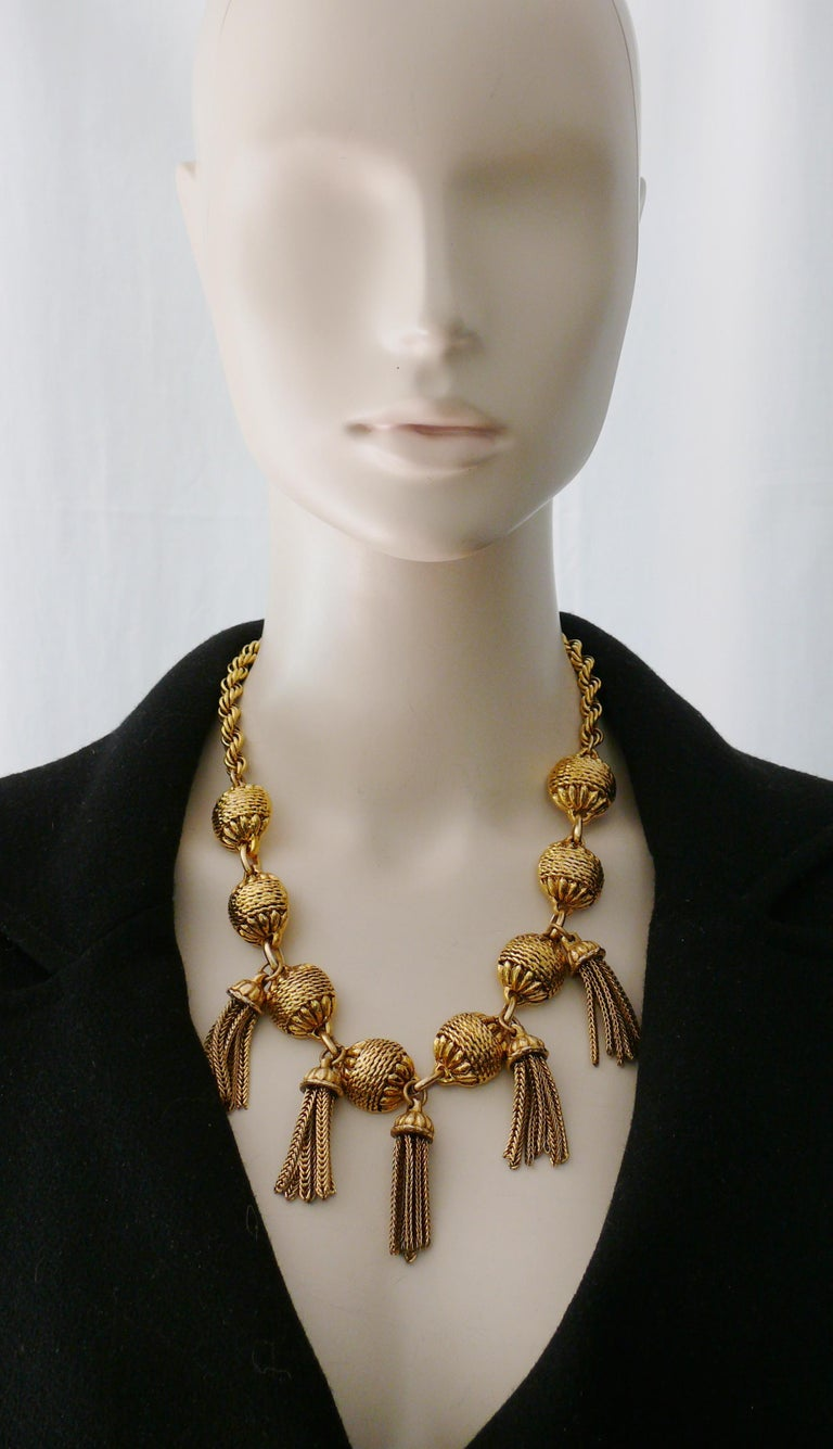 SATELLITE Paris vintage antiqued gold toned necklace and clip-on earrings embellished with chain tassels.  Embossed SATELLITE on the necklace t-bar closure and round links. Matching earrings are unmarked.  NECKLACE indicative measurements : length