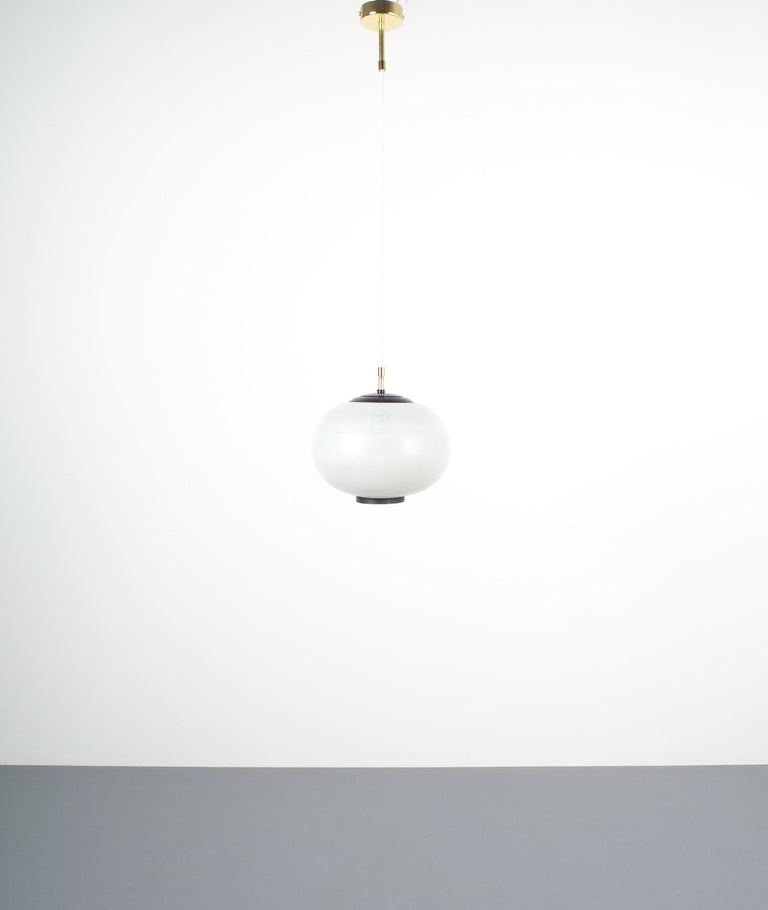 Satin glass and brass pendant lamp by Stilnovo, Italy, 1950. Elegant suspension pendant lamp with stripped satin white glass and black metal paint accents. We have rewired this piece and facilitated with new white cord cables and new modern canopy.