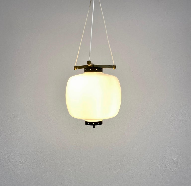 Suspension pendant light with satin glass and brass hardware by Stilnovo, Italy, 1950  Elegant suspension pendant lamp with a three-cord suspension and original canopy. The fixture is in original condition with no damages to the glass, fully