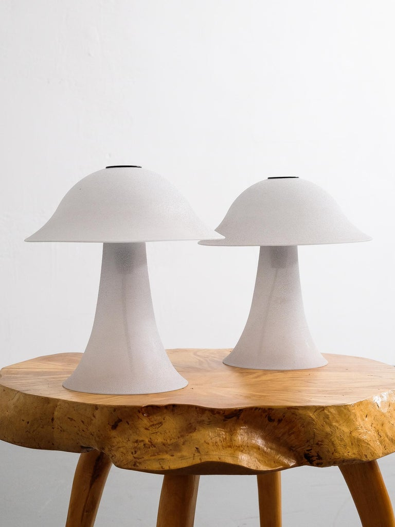 Peill & Putzler pair of vintage 'Mushroom' table lamps made in Germany, circa 1970s. Both lamps consist of a quality hand blown glass base and shade which is fastened with a black circular plate at the top. The light grey glass has an elegant