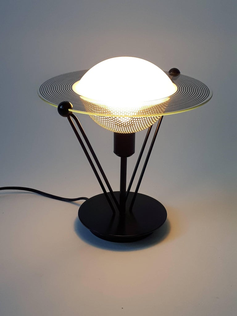 Small, solid and well made black semi-gloss metal base and structure.