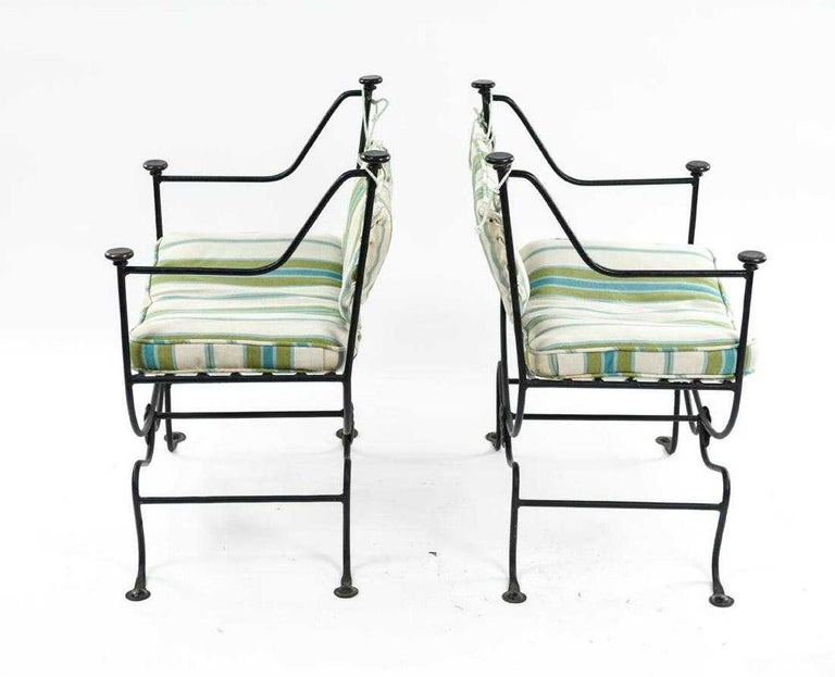 Italian Savonarola style chairs with wrought iron with blue green and white stripped loose cushion on seats.  Chairs c an be used indoor or outdoors. Great as end dining chairs with cushions and back support.  Cushions are in poor condition and are