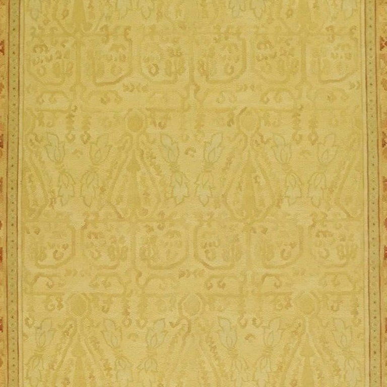 A medieval silk brocade with Saffavid and Andalusian influences inspired this saffron ground and amber tonal border. This hand made cut and loop pile rug was made by combining a loop weave invented by Asmara with the ancient French Savonnerie pile