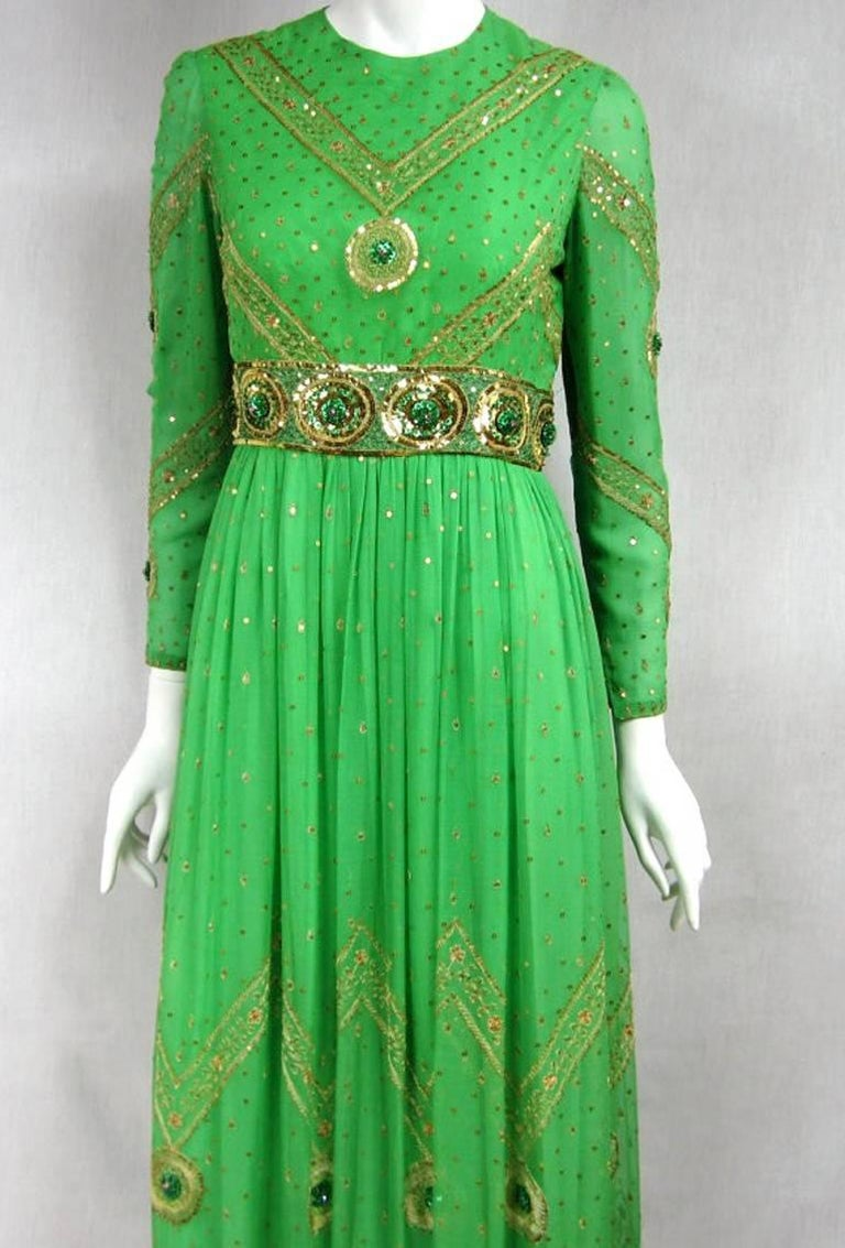 1970's Silk Dream Gown and this color is amazing. Flowing Layers of silk. Has a Hidden Zipper down the back, 3 hook, and eye closures. Snaps on the wrist Loads of sparkle scattered throughout this amazing gown paillette sequins, Saz by Surjit and