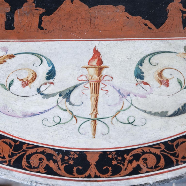 Round tabletop, decorated in Scagliola technique. A band in terracotta-color on a black ground frames the tabletop and depicts leaping panthers and vines. The white tabletop shows two polychrome torches surrounded by leaves and a central panel,