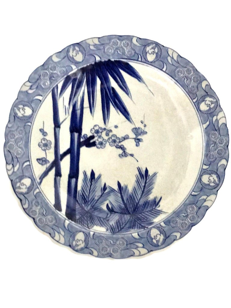 Lovely scalloped edge blue and white Japanese porcelain Imari Charger. The charger is decorated with Shochikubai meaning