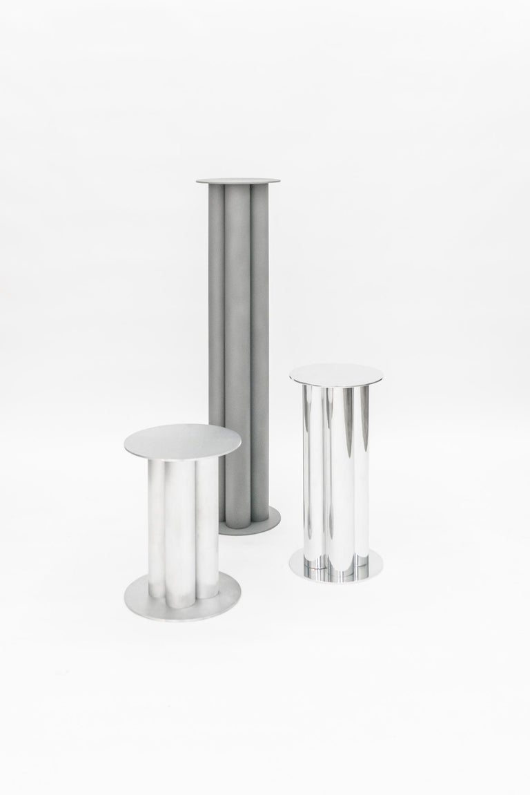 TOTEMs reimagine the pedestal as an architectural form. Reminiscent of a column, Deon Rubi takes this classical shape and gives it a Minimalist contemporary twist. Made of aluminum and available in different finishes (polished, sandblasted, or