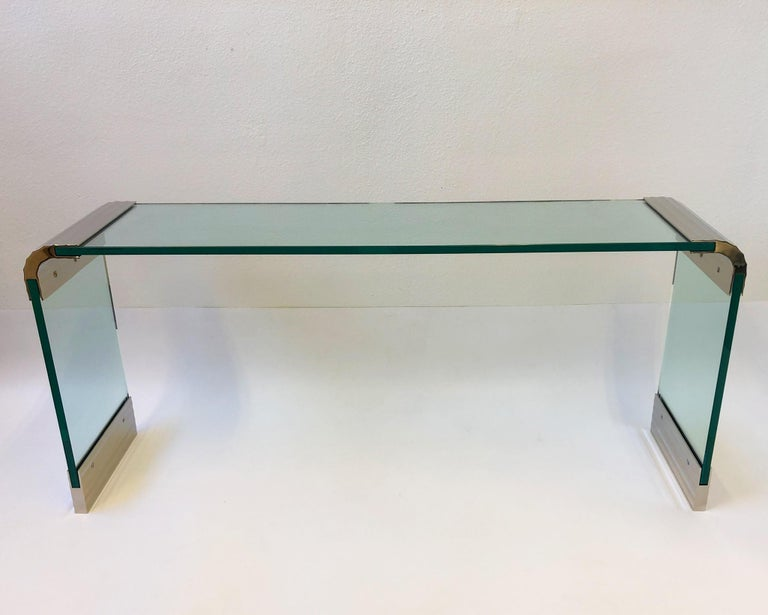 "A spectacular scalloped polish nickel and glass waterfall console table designed by Leon Rosen for Pace collection in the 1970s. The table has new 3/4"" thick glass and brackets have been newly nickel plated. If you want different length let us"